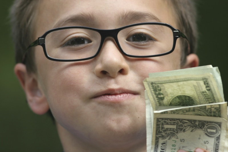 boy holding money
