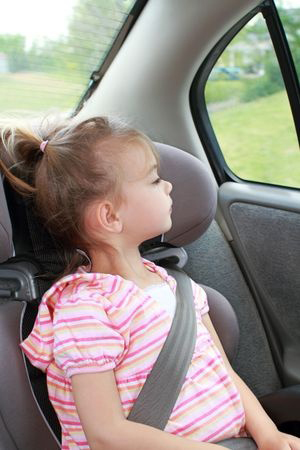 young girl in a booster seat