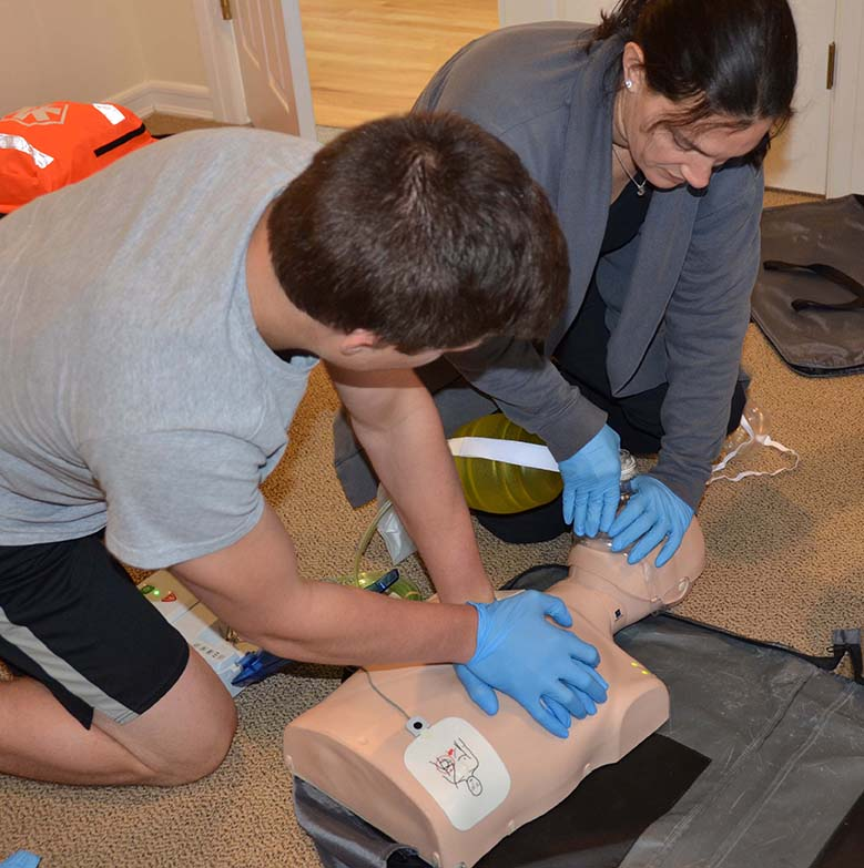 two people practicing two-person CPR