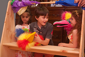 children playing puppet theater